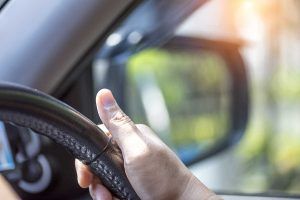 Close Up Hand Driving Car With Side Mirror Background Safety Driving Concept